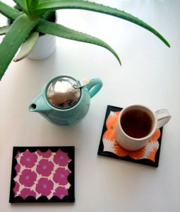 DIY coasters/trivets made from old CD jewel cases.