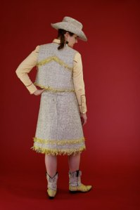 Cowgirl hat, vest and boots made from a phonebook and CDs.